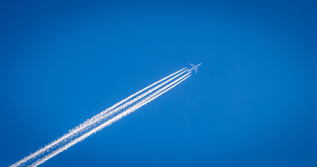 Plane with contrails in the sky