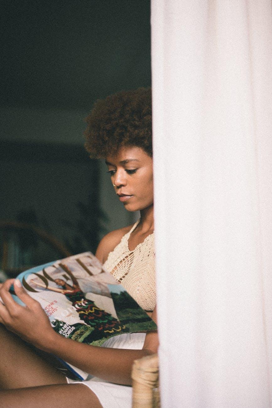 Woman looking at magazine