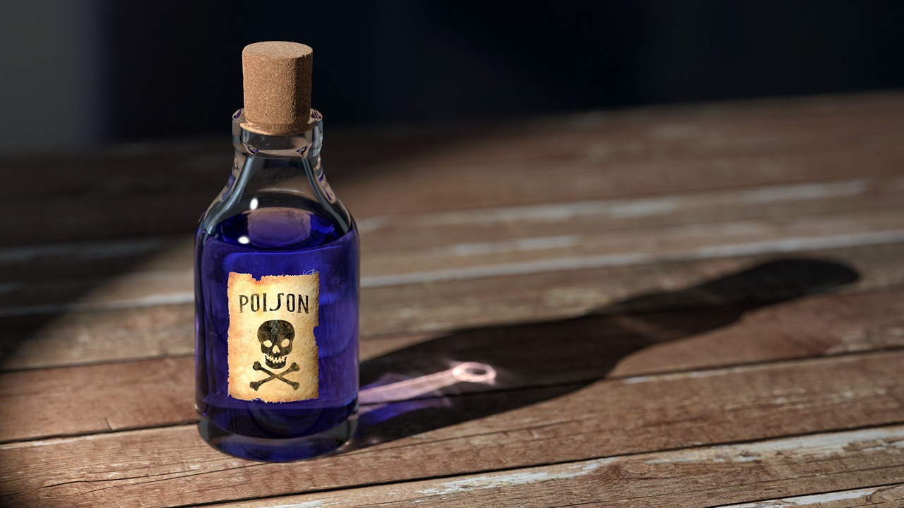Vial with poison written on the front with a skull and cross bones