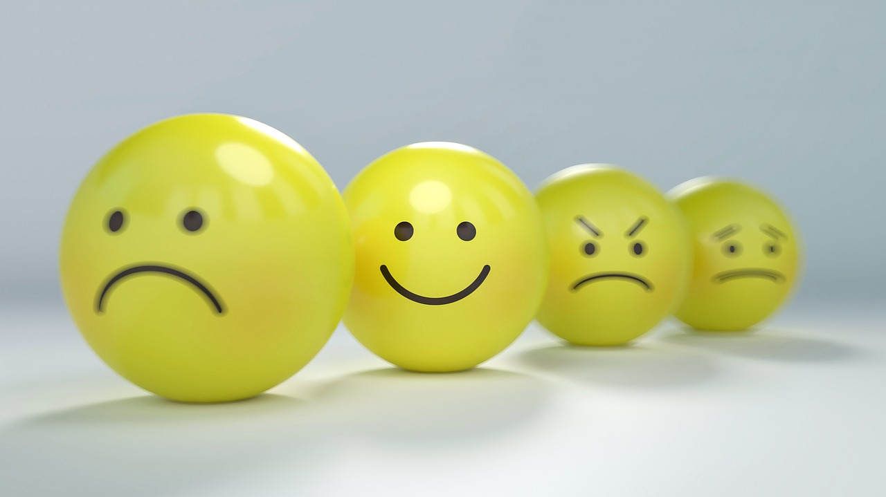 Line of balls are seen with faces on them of varying emotions